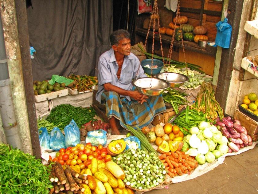 Sri_Lanka_-_078_-_Colourful_veggie_shop_in_Kandy_(1685043708)